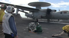 E-3 Hawkeye aircraft launch from USS Ronald Reagan Stock Footage