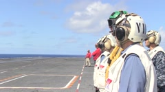 Rear Admiral Gilles watching a aircraft launch from USS Ronald Reagan Stock Footage