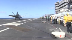 Rear Admiral Gilles watching a landing on USS Ronald Reagan Stock Footage
