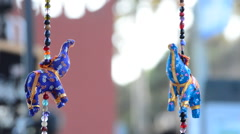 Indian elephants hanging in hawker stall craft Stock Footage