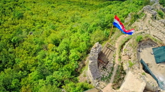 Croatian flag on Necven ruins, aerial Stock Footage