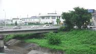 Stock Video Footage of Cars Driver Across Bridge Over Hirai-gawa River In Fussa Tokyo 4K