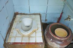 Old toilet in the countryside home. Stock Photos