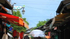 Tourists walking along the street of the Japanese city. Stock Footage