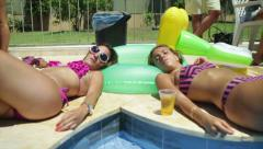 Sexy girls chilling in pool Stock Footage