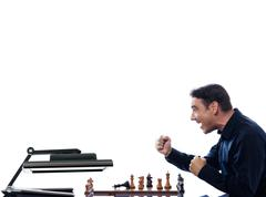 man playing chess computer defeat - stock photo