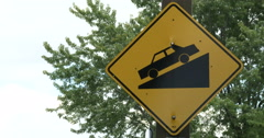 Steep slope road traffic sign Stock Footage