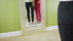 Woman with positive body image stepping on scale Stock Footage
