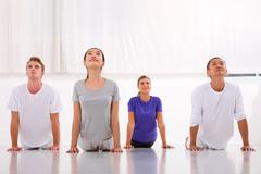 multiethnic group of people practicing yoga - stock photo