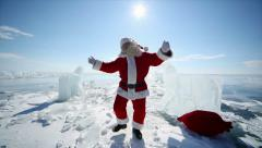 Santa claus is dancing near the ice knight Stock Footage
