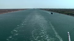 Egypt the Suez Canal 054 ship convoy behind stern wave Stock Footage