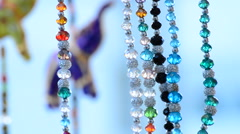 Detail jewelry hanging in hawker stall craft 2 Stock Footage