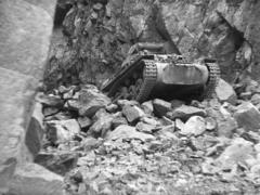 WW2 German Tanks Proceeding Over Falling Rocks Stock Footage