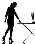 Business woman igniting computer computing  silhouette Stock Photos