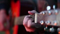 closeup of an acoustic guitar fret and fingers - stock footage