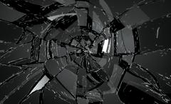shattered or damaged glass pieces on black - stock photo