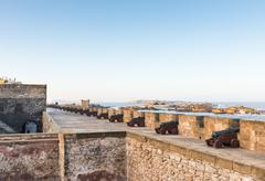 the cannons on the skala de le ville fort - stock photo