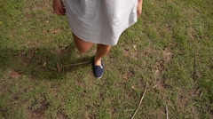 Young Female Legs Walking on the Grass. Slow Motion. Stock Footage