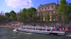 A point of view of a bateaux mouche riverboat traveling along the Seine River in Stock Footage