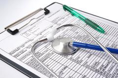 medical chart with stethoscope - stock photo