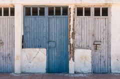 the old blue doors of the deserted room - stock photo