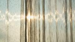 Light streams through sheer curtains Stock Footage