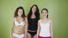 Candid portrait of happy attractive young women with different body shapes. - stock footage