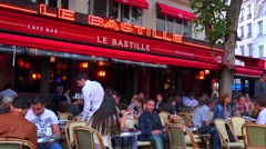 A classic Paris outdoor cafe with waiters serving. Stock Footage