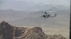 Huey Helicopter in Flight WAR in Afghanistan Stock Footage