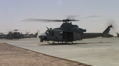 Huey Helicoptes Idling on Tarmac Stock Footage