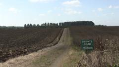 Patchy sunshine on farm track timelapse Stock Footage