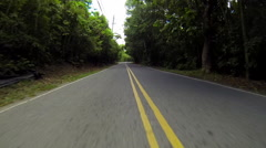 jeep riding down the road in the USVI - stock footage