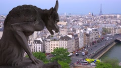 Classic shot of gargoyles watch over Paris, France from Notre Dame cathedral. - stock footage