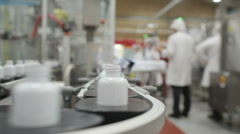 Workers in pharmaceutical manufacturing facility factory Stock Footage