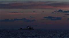 Barge ship at sea with sunset backdrop Stock Footage