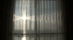 Sun through a sheer curtain - stock footage