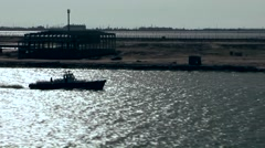 Egypt the Suez Canal 068 Port Said; pilot boat in glittering water against light Stock Footage