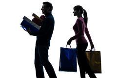 Couple woman man  christmas present shopping silhouette Stock Photos