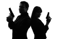 couple woman man detective secret agent criminal  silhouette - stock photo