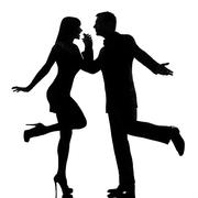 One couple man and woman dancing rock silhouette Stock Photos