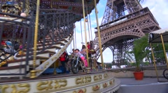 Tilt up from a Merry Go Round to the Eiffel Tower, Paris. Stock Footage