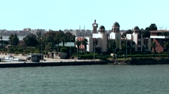 Egypt the Suez Canal 069 Port Said buildings and watchtower on a spit of land Stock Footage