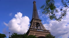 Low angle view of the Eiffel Tower in Paris with cloudy sky. Stock Footage
