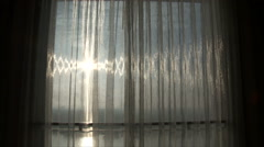 Stock Video Footage of Opening Shiny Curtain to Silhouetted Man