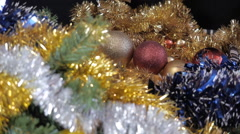 Yellow and red ball on the Christmas tree. Colored Christmas tinsel. Stock Footage