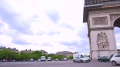 Traffic circles around the Arc De Triomphe in Paris, France. - stock footage