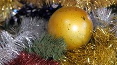 Christmas yellow ball on the Christmas tree. The play of light. Tinsel. - stock footage