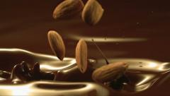 Falling almonds in liquid chocolate Stock Footage