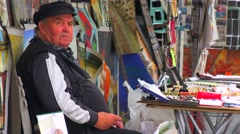A street vendor in Paris sells magazines and artwork. Stock Footage