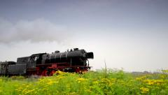 Steam locomotive with passenger cars Stock Footage